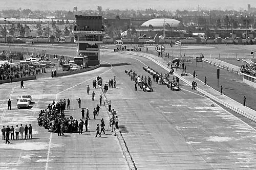 View of starting grid area, 1964 Mexican Grand Prix