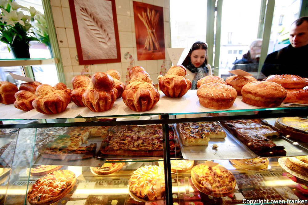 Sunday at the Bakery of Jacques Bazin, Paris..Brioches for sale, including the 400 gram brioche
