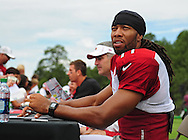 Jul. 28, 2012; Flagstaff, AZ, USA; Arizona Cardinals wide receiver Larry Fitzgerald (11) reacts during training camp practice on the campus of Northern Arizona University.  Mandatory Credit: Jennifer Stewart-US PRESSWIRE.