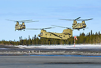 A flight of three US Army helicopters make a fuel stop at Whitehorse International Airport
