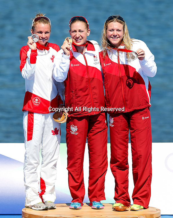 24.07.2014. Glasgow, Scotland. Glasgow 2014 Commonwealth Games. Womens Triathlon. L-R Runner-up Vicky Sweetland of Canada, Winner Jodie Stimpson of England and third placed finisher Vicky Holland of England pose with their medals on the podium.