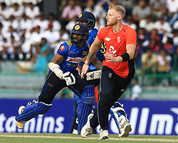 October 23, 2018 - Colombo, Sri Lanka - Sri Lankan cricketers Dinesh Chandimal and Niroshan Dickwella run between the wickets as England's Ben Stokes looks on ..during the 5th One Day International cricket match between Sri Lanka and England at the R Premadasa International Cricket Stadium  Sri Lanka. Tuesday 23 October 2018  (Credit Image: © Tharaka Basnayaka/NurPhoto via ZUMA Press)