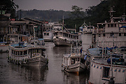 Fishing boats approach an informal dock in Santana village, near Macapa, Amapa state capital in Brazil, Tuesday, Oct. 25, 2016. Bathed by the Amazon river mouth  this northernmost capital of 400.000 residents is as filled with canals, informal docks and unregistered boats as it lacks infrastructure and control means for fighting the rising river piracy plaguing passengers and transportation companies. (Dado Galdieri for The New York Times)