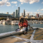 A welder works on the support beams of a new solar paneled electric car charging station at Northerly Island in Chicago, Wednesday, October 27, 2010. Photo by J. Geil.