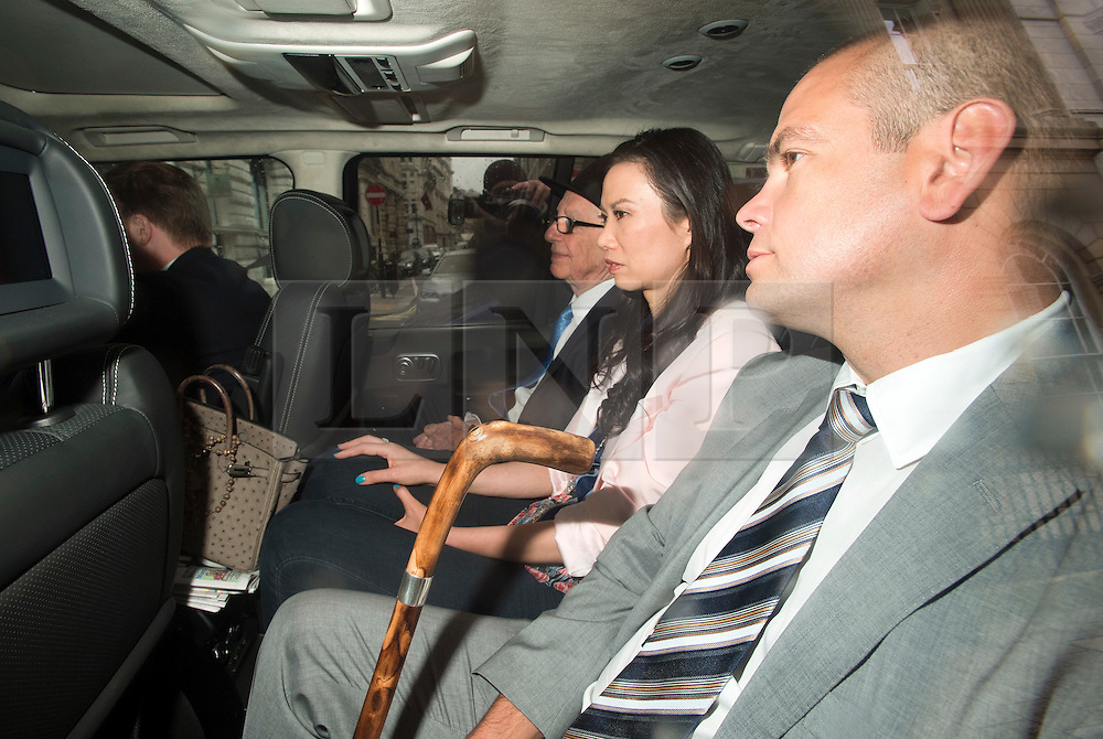 © London News Pictures. 26/04/2012. London, UK. Rupert Murdoch (left)  being driven from The High Court in London with his wife Wendy Deng Murdoch (centre)  and son Lachlan (right), on April 26, 2012 after giving evidence to the Leveson inquiry.  Photo credit : Ben Cawthra /LNP