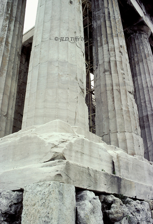Acropolis, Parthenon: details of temple base and substructure.  Corner of the damaged temple platform or stylobate, with lower part of column shafts..