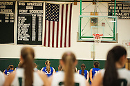 The teams line up to listen to the National Anthem before the start of the girls basketball game between Vergennes and Winooski at Winooski High School on Wednesday night December 9, 2015 in Winooski. (BRIAN JENKINS/for the FREE PRESS)