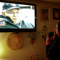 "Paula Hatch gets chocked up as she watches an interview with her father, Don Hatch, Jr., on the news the day after several family relatives were involved in a shooting at Marysville-Pilchuck High School in Marysville, Washington October 25, 2014. Relatives of a Washington state teen accused of a high school shooting rampage said on Saturday that they were living in a ""nightmare"" and struggling to understand why the boy targeted his two cousins and several friends before killing himself. One girl was killed and four other freshman students were severely wounded in Friday's morning rampage inside the cafeteria at Marysville-Pilchuck High School, north of Seattle. REUTERS/Jason Redmond (UNITED STATES - Tags: CRIME LAW SOCIETY)"