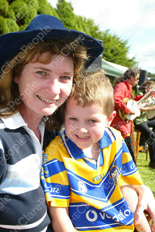 Feakle Festival on Sunday 13th August has a great turn out with the square packed with locals &amp; foreigners alike all enjoying the trad session open air concert put on by Dutch band 'Harmony Glen&quot;. Pictured is Mary Mulcahy with her nephew Cathal Walsh (5) both from Killaloe.<br />Pic. Emma Jervis/ press 22