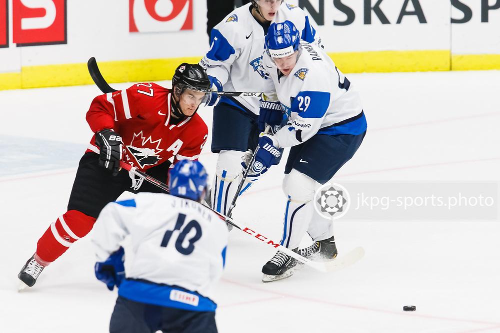 140104 Ishockey, JVM, Semifinal,  Kanada - Finland<br /> Icehockey, Junior World Cup, SF, Canada - Finland.<br /> Jonathan Drouin, (CAN), Otto Rauhala, (FIN).<br /> Endast f&ouml;r redaktionellt bruk.<br /> Editorial use only.<br /> &copy; Daniel Malmberg/Jkpg sports photo