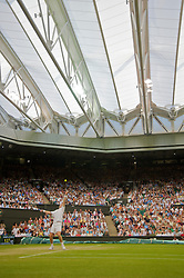 LONDON, ENGLAND - Monday, June 29, 2009: Andy Murray (GBR) serves under the new Centre Court roof during the Gentlemen's Singles 4th Round match on day seven of the Wimbledon Lawn Tennis Championships at the All England Lawn Tennis and Croquet Club. (Pic by David Rawcliffe/Propaganda)