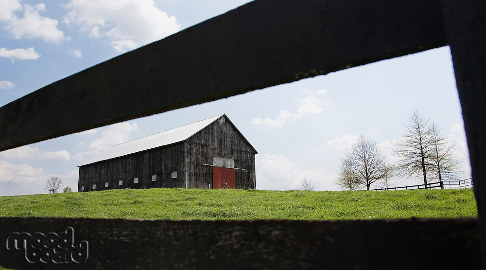 Barn in field with fence