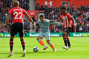 Eden Hazard (10) of Chelsea battles for possession with Mario Lemina (18) of Southampton during the Premier League match between Southampton and Chelsea at the St Mary's Stadium, Southampton, England on 7 October 2018.