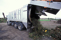 green waste collection vehicle at landfill site