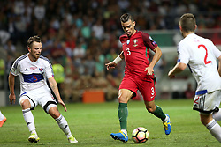 August 31, 2017 - Porto, Portugal - Portugal's defender Pepe (C ) vies with Faroe Islands' defender Viljormur Davidsen (L) and Faroe Islands' midfielder Jonas Tor Naes during the 2018 FIFA World Cup qualifying football match between Portugal and Faroe Islands at the Bessa XXI stadium in Porto, Portugal on August 31, 2017. (Credit Image: © Pedro Fiuza/NurPhoto via ZUMA Press)
