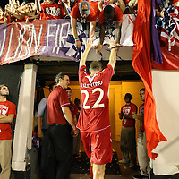 Lions Defender Rob Valentino (22) celebrates with fans after the United Soccer League Pro American Division Championship soccer match between the Richmond Kickers and the Orlando City Lions at the Florida Citrus Bowl on August 27, 2011 in Orlando, Florida. Orlando won the match 3-0 to advance to the USL Pro Final.  (AP Photo/Alex Menendez)
