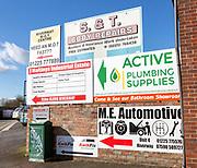 Signs for businesses on Maltings Industrial Estate, Trowbridge, Wiltshire, England, UK