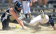 Bella Lara of Sudden Impact (Woodlands, Texas) slides safely into home plate as Rylee Carlson of the PV Spartans (Pleasant Valley, Iowa) loses control of the ball during an ASA softball game at Green Valley Sports Complex in Moline on Wednesday, August 1, 2012.