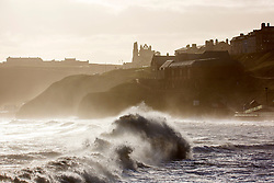 © Licensed to London News Pictures. 25/03/2019. Whitby UK. Strong winds whip up the sea this morning in Whitby on the Yorkshire coast. UK Photo credit: Andrew McCaren/LNP