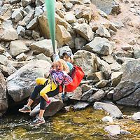 Team tyrolean. @kristine.hoffman and daughter work there way across Boulder Creek. #adventurekids @patagonia_climbing #kids #denvercelebrateswild #mountainscape  #colorado #adventurelifestyle  #outdoorphotography @thegreatoutdoors @blackdiamond #tyroleantraverse #aacgram