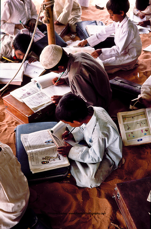 Al Amrah children studying at their desert school in the Dahana Sands.  The teacher was Abdul Wahab Mahmood Abdullah. Saudi Arabia