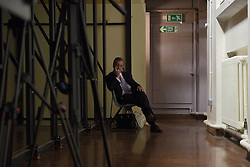 "© London News Pictures. ""Looking for Nigel"". A body of work by photographer Mary Turner, studying UKIP leader Nigel Farage and his followers throughout the 2015 election campaign. PICTURE SHOWS - A tired Nigel Farage takes a moment to rest while campaigning after a long and often frantic two days touring the Midlands, at the Haven High Academy in Boston, LincolnsHire, on April 8th 2015. . Photo credit: Mary Turner/LNP **PLEASE CALL TO ARRANGE FEE** **More images available on request**"