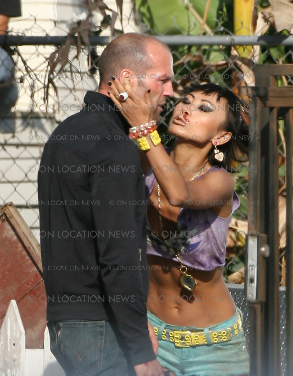 LOS ANGELES, CALIFORNIA - FRIDAY 2ND 2008. NON EXCLUSIVE: Jason Statham and Bai Ling filming some outrageous action scenes for 'Crank 2 '. In various scenes, Statham storms into a Brothel holding a meat cleaver while scantily clad girls rush out. The balding actor then rushes upstairs and throws a man out of the window. Later Bai Ling hugs and kisses Statham to thank him for saving her life, only to be rejected by him. Both actors seem to be having lots of fun filming their scenes in the 80 degree LA heat in a gritty neighborhood of Los Angeles. Photograph: On location News. Sales: Eric Ford 1/818-613-3955 info@OnLocationNews.com Photographer Code: ECF
