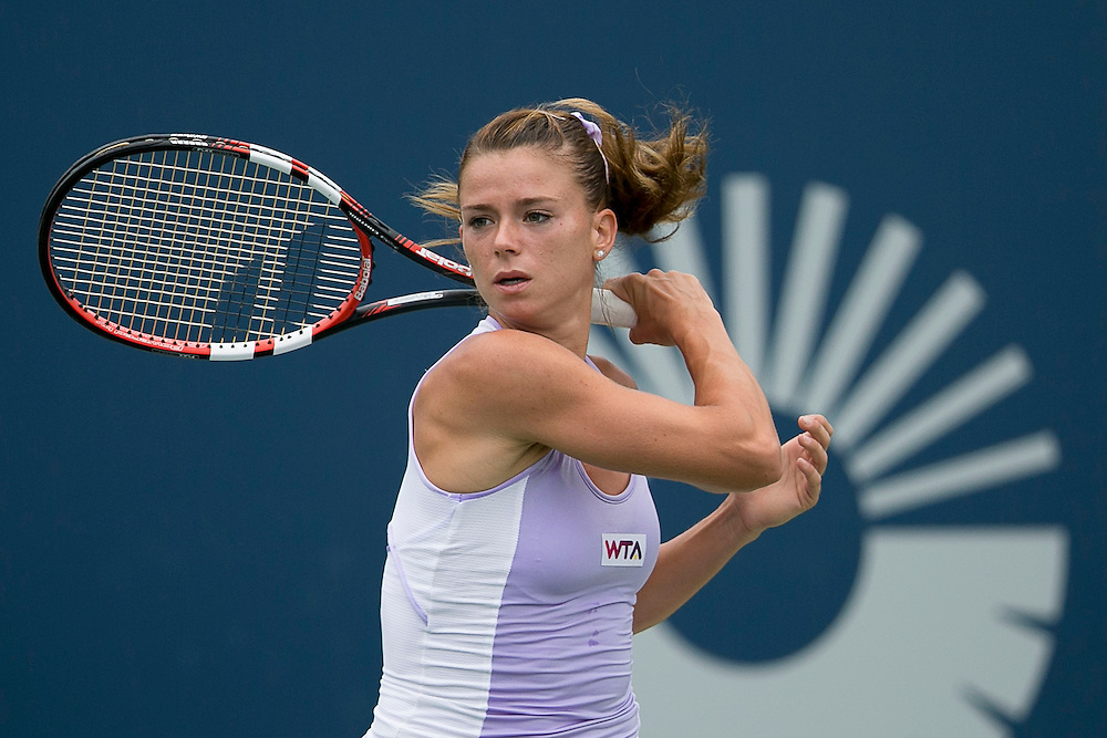 August 22, 2014, New Haven, CT:<br /> Camila Giorgi hits a backhand during the semi-final match against Magdalena Rybarikova on day eight of the 2014 Connecticut Open at the Yale University Tennis Center in New Haven, Connecticut Friday, August 22, 2014.<br /> (Photo by Billie Weiss/Connecticut Open)