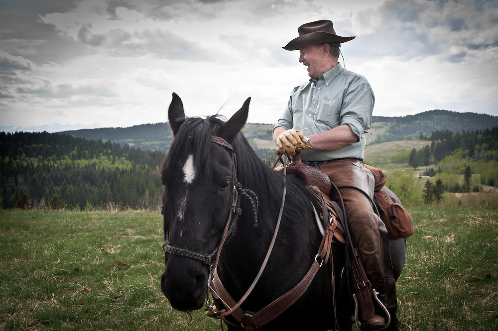 PR photography for the Nature Conservancy of Canada (NCC). Cowboy riding horse at Providence Ranch (Kerfoot Property), Wildcat Hills, Alberta