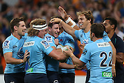 Waratah Matt Carraro , centre, celebrates his try against the Highlanders in the Super 15 rugby match, Forsyth Barr Stadium, Dunedin, New Zealand, Saturday, March 14, 2015. Credit: SNPA/Dianne Manson