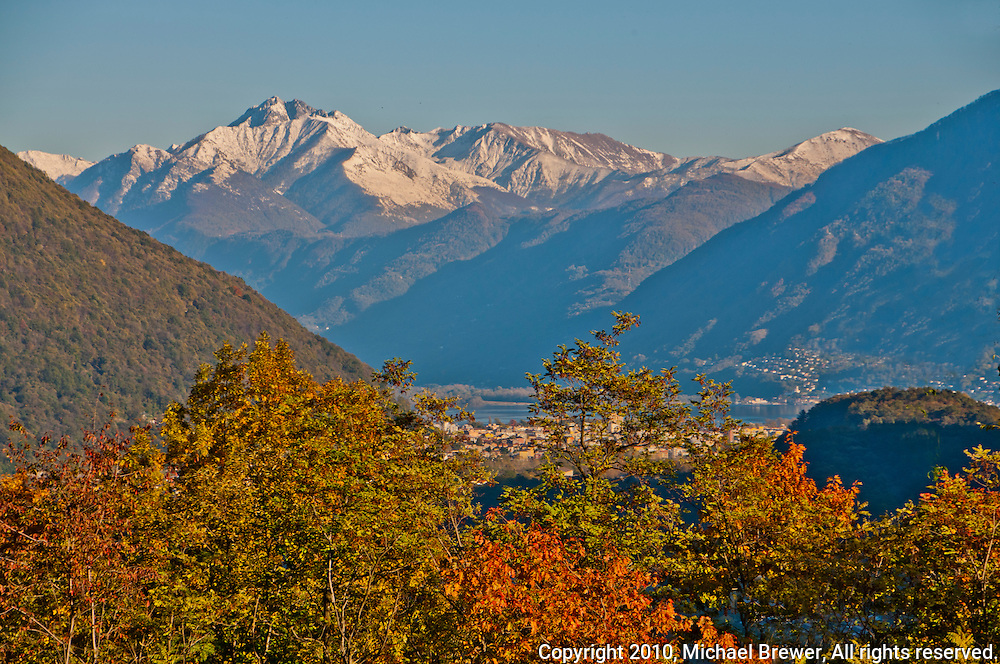 Autumn view over Locarno with a background of snow peaked mountains in Ticino, Southern Switzerland.