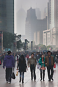 Enthusiastic Chinese shoppers ply the main shopping district of Shanghai.  A portion of Shanghai's business district can be seen in a veil of air pollution that cloaks the city