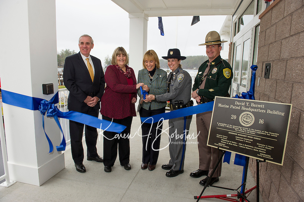 Commissioner John Barthelmes, Wendy Barrett, Governor Maggie Hasson, Lieutenant Crystal McLain and Colonel Christopher Wagner have the honor for the official ribbon cutting during the David T. Barrett Marine Patrol headquarters building dedication ceremony on Tuesday morning.  (Karen Bobotas/for the Laconia Daily Sun)