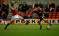 Photo: Richard Lane/Richard Lane Photography. Nottingham Forest v Blackpool. Coca Cola Championship. 13/12/2008. Chris Cohen (L) tries to block Joe Martin (R)