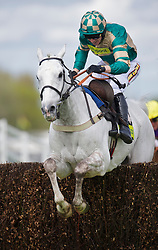 LIVERPOOL, ENGLAND, Thursday, April 7, 2011: Paddy Brennan riding Nacarat jumps the last fence of the Totesport Bowl Steeple Chase to win the race during Liverpool Day on Day One of the Aintree Grand National Festival at Aintree Racecourse. (Photo by David Rawcliffe/Propaganda)