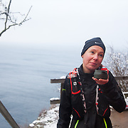A runner comes up the stairs from Jon's Chapel where she has been down to ring the bell below and gets a drink at one of the two break points on the route. Salomon Hammer Trail Winter Edition is a first on Bornholm and is one of the toughest routes in Denmark. The 4 runs consist of a 50 mile run, a marathon, a 1/2 marathon and 10k all run a on an approximate 25km route which includes 860 meter vertical rise on the North East coast of the Danish island Bornholm. The cut-off time for the 50mile run was 16 hours and more than a hundred runners made it to the finishing line. The last runner across the line after 50 miles  was in after 15:14:40