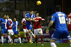 Peterborough United's Nat Knight-Percival in action with Swindon Town's Raphael Rossi Branco - Photo mandatory by-line: Joe Dent/JMP - Tel: Mobile: 07966 386802 11/01/2014 - SPORT - FOOTBALL - County Ground - Swindon - Swindon Town v Peterborough United - Sky Bet League One