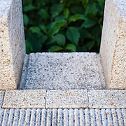White granite curb inlet to stormwater planter detail of stormwater management facilities, Director Park, Portland, Oregon.