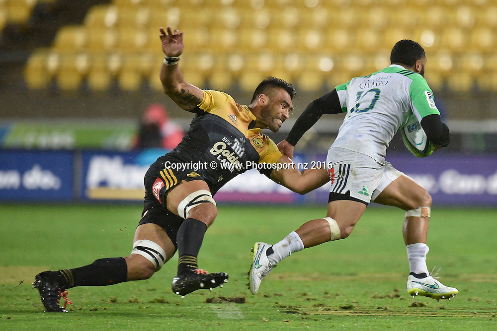 Highlanders' Lima Sopoaga  (R is tackled by Hurricanes' Victor Vito during the Hurricanes vs Highlanders Super Rugby  match at the Westpac Stadium in Wellington on Friday the 27th of May 2016. Copyright Photo by Marty Melville / www.Photosport.nz