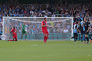 Keith Lowe remenstrates with the referee after Stephane Zubars own goal during the Sky Bet League 2 match between Wycombe Wanderers and York City at Adams Park, High Wycombe, England on 8 August 2015. Photo by Simon Davies.
