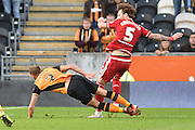 Fernando Amorebieta of Middlesbrough FC brings down Hull City midfielder David Meylerduring the Sky Bet Championship match between Hull City and Middlesbrough at the KC Stadium, Kingston upon Hull, England on 7 November 2015. Photo by Ian Lyall.