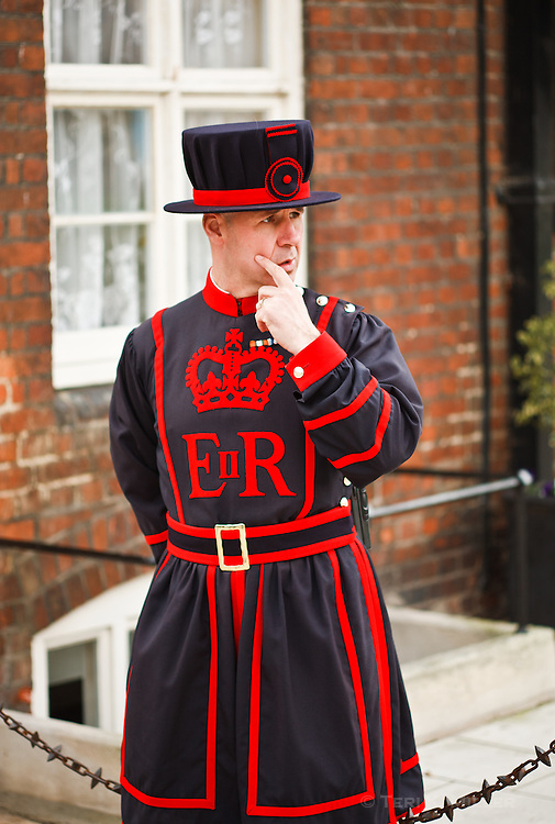 A beefeater at the Tower of London, London, England.