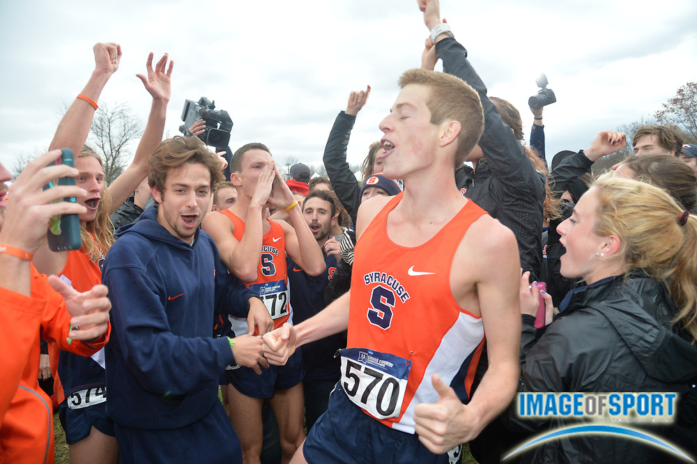 Nov 21, 2015; Louisville, KY, USA; Martin Hehir (570) celebrates after Syracuse won the team title during the 2015 NCAA cross country championships at Tom Sawyer Park.