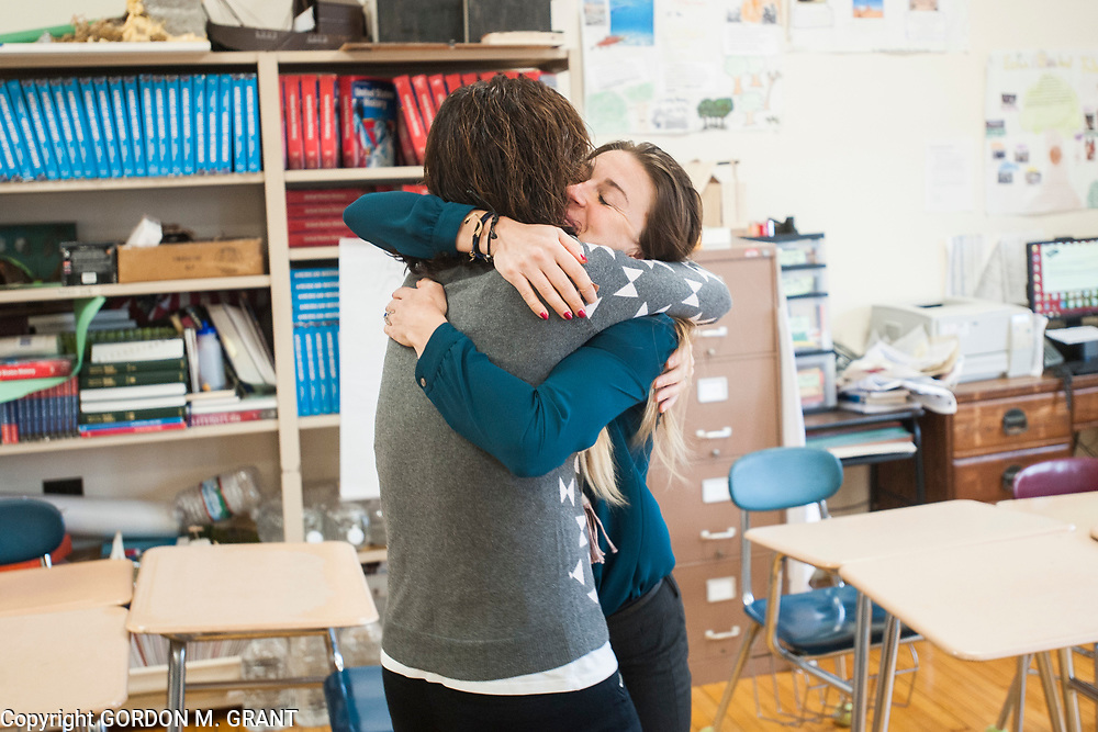 Cara Nelson, right, a seventh grade social studies teacher at East Hampton Middle School, gets a hug from one of her fellow teachers, Adrienne Posillico, upon returning from her recent trip that involved running seven marathons in seven days on seven continents, in East Hampton, Feb. 7, 2018. This was Nelson's first day back to school after finishing her last marathon on Monday in Miami.