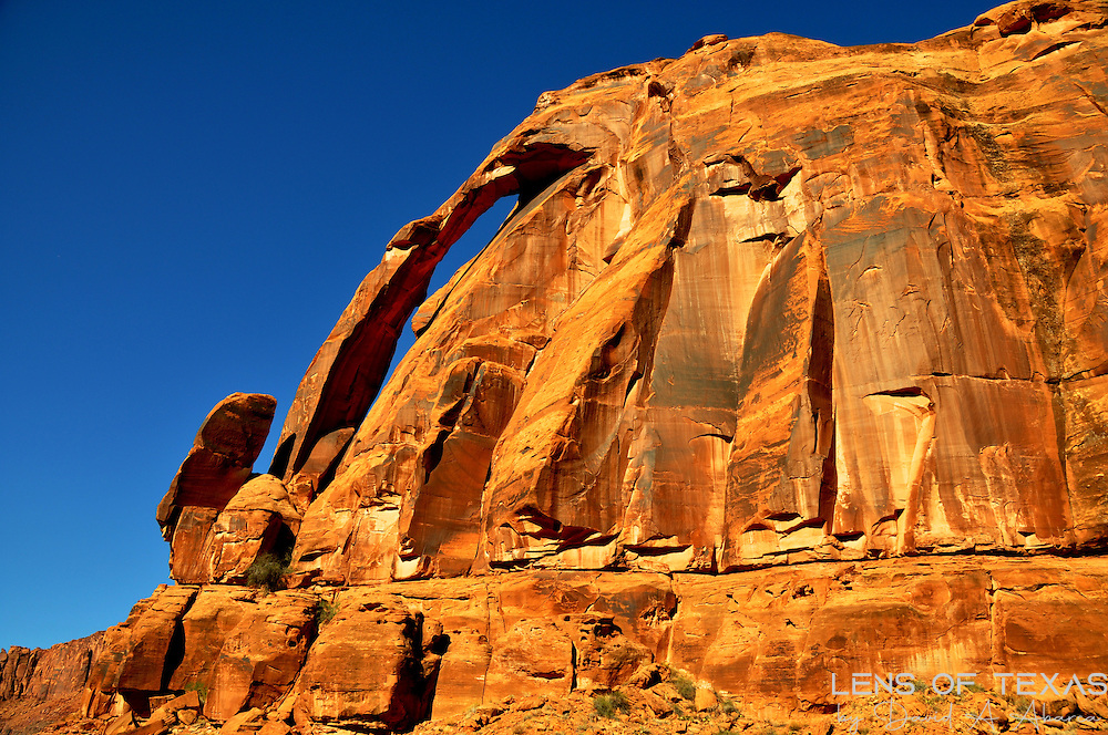 This is Jug Handle Arch with the deep blue sky in Canyonlands National Park.