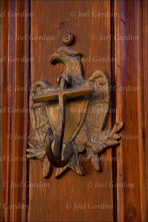 Decorative and functional brass eagle and nautical door knocker on door at 310 West 11th Street in Greenwich Village, NYC.