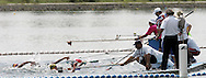 Team members hold out drinks for swimmers during the women's 25km open water swimming competition at the FINA World Championships in Montreal, Quebec Friday 22 July 2005.