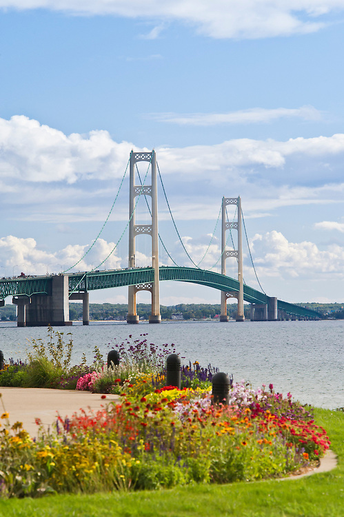 The Mackinac Bridge and flowers seen from a park in St. Ignace, Michigan.