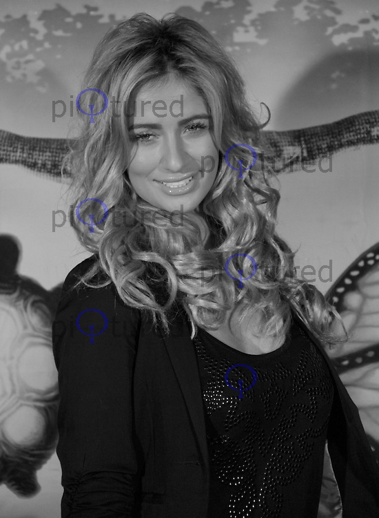 Chantelle Houghton Cirque Du Soleil Totem Press Night Premiere, Royal Albert Hall, London, UK, 05 January 2011:  Contact: Ian@Piqtured.com +44(0)791 626 2580 (Picture by Richard Goldschmidt)