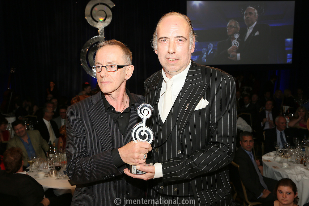 (l-r) Nick Headon and MIck Jones of The Clash. The Silver Clef Lunch 2013 in aid of  Nordoff Robbins held at the London Hilton, Park Lane, London.<br /> Friday, June 28, 2013 (Photo/John Marshall JME)